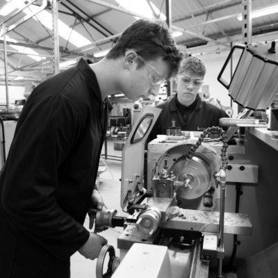 Technical Support Technician apprentice using machinery