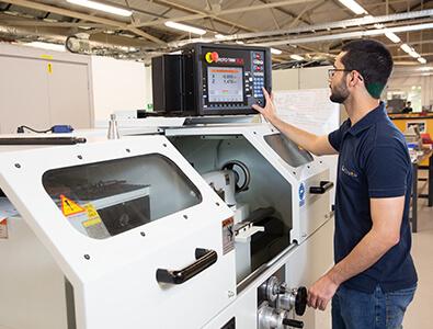 Machinist apprentice using CNC machine