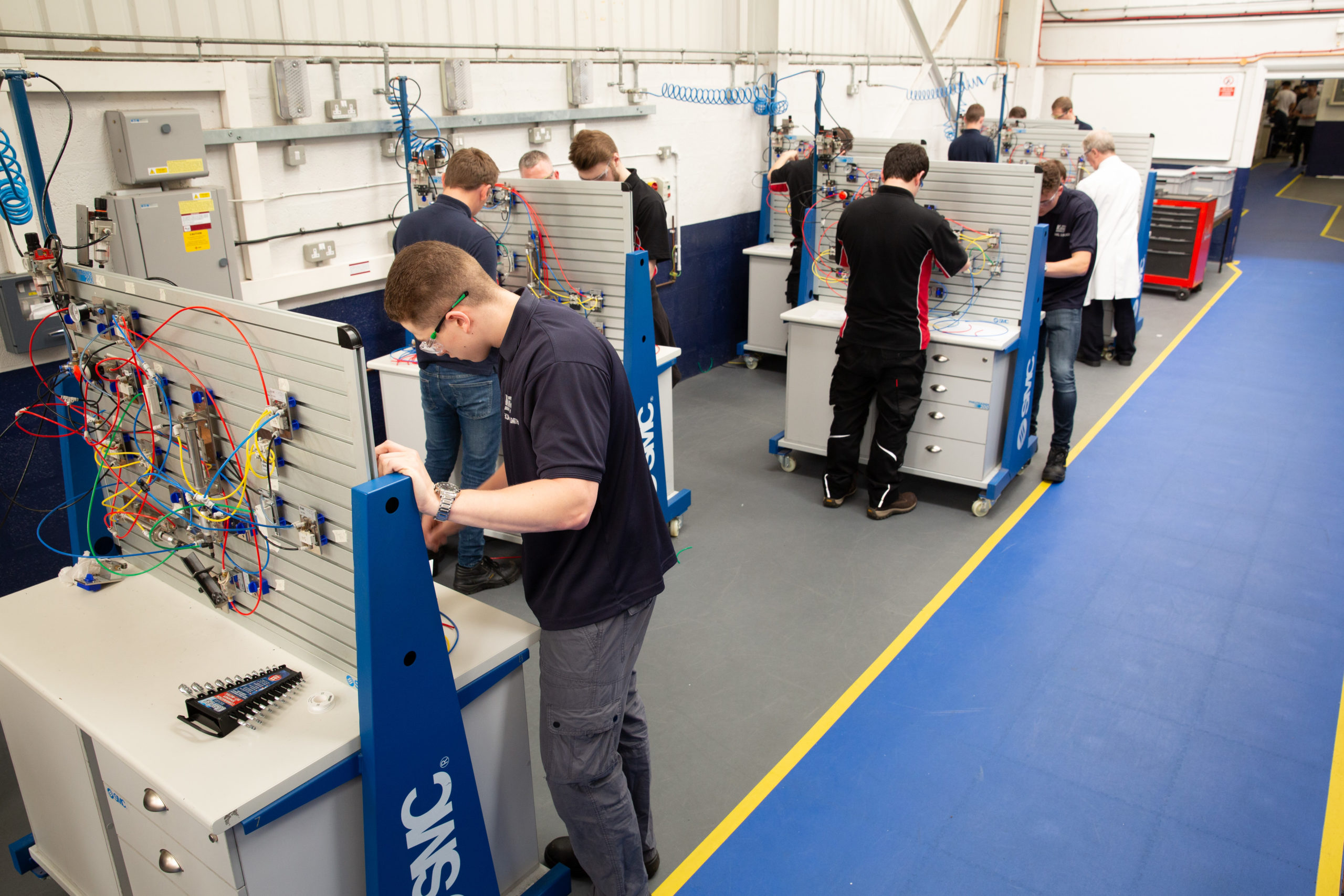 Mechatronics Maintenance Technician apprentices in workshop doing Pneumatic circuit building