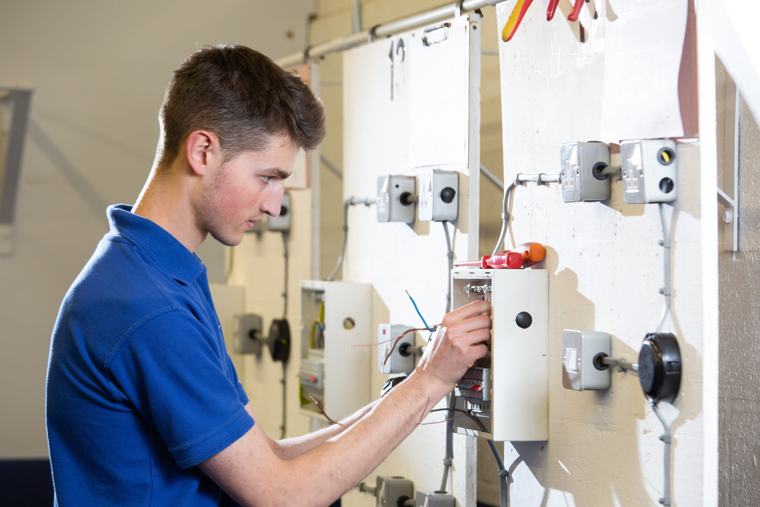 Mechatronics Maintenance Technician apprentice working on an electrical installation