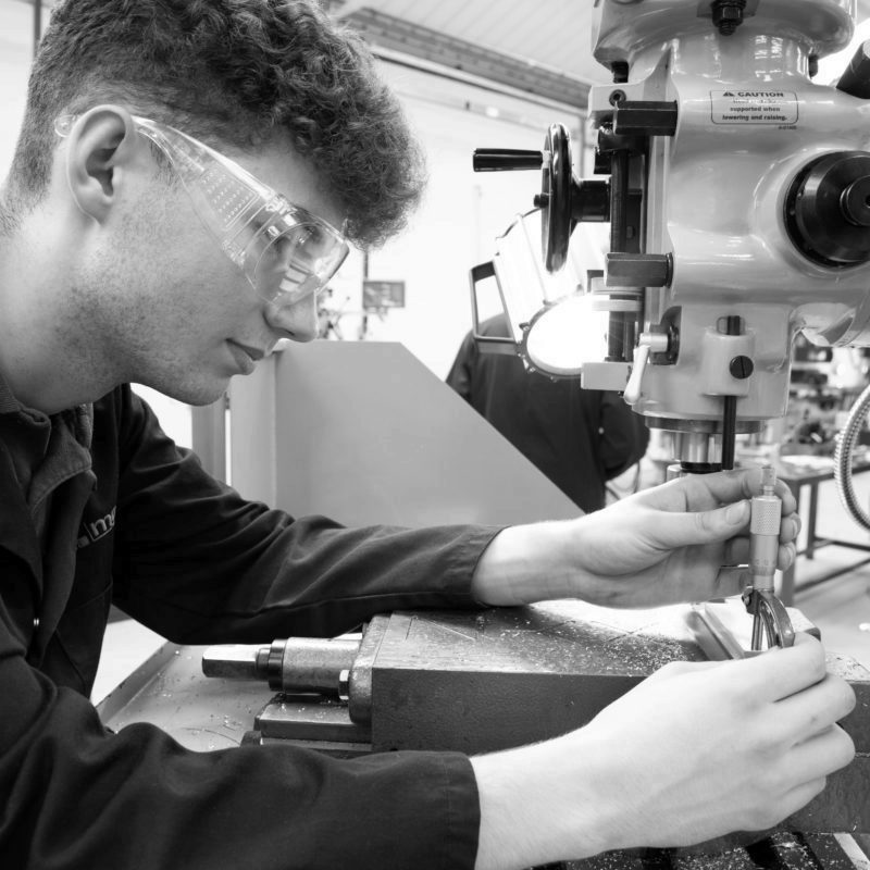 Toolmaker and Tool & Die Maintenance Technician apprentice inspecting a machined component