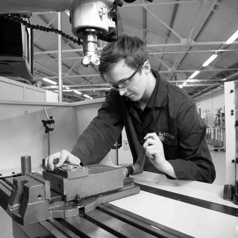 Machinist apprentice setting vice on a milling machine