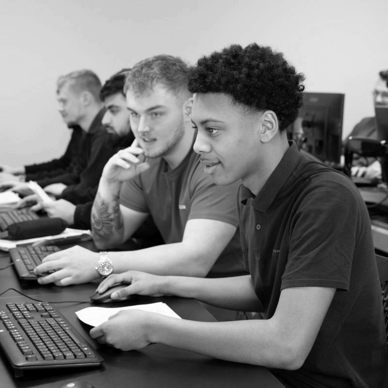 Two engineering apprentice working on computer
