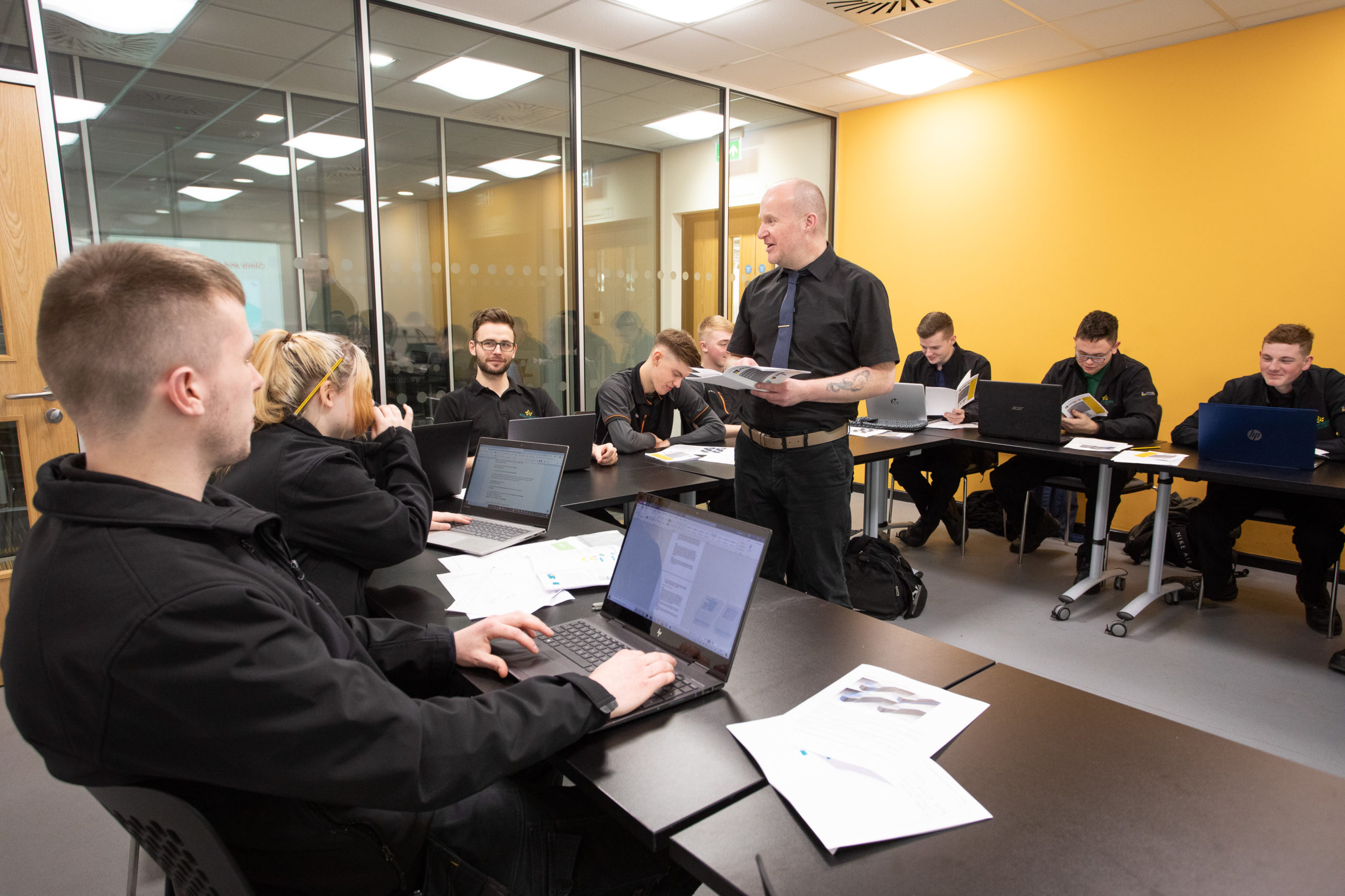 Man teaching Food and Drink Engineering Maintenance Technician apprentices in classroom