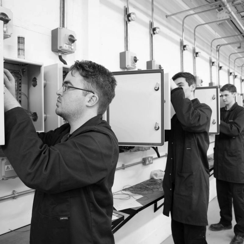 Product Design & Development Technician apprentices working on Electrical Installation and Motor Control