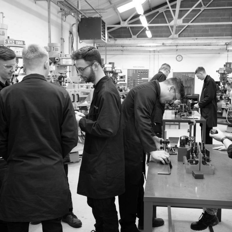 Engineering apprentices working in Milling area